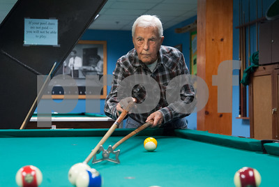 12/05/17   Wesley Bunnell | Staff  Gaston Toussaint, age 94, shoots during a game of 8 ball at the Bristol Senior Center on Tuesday afternoon.