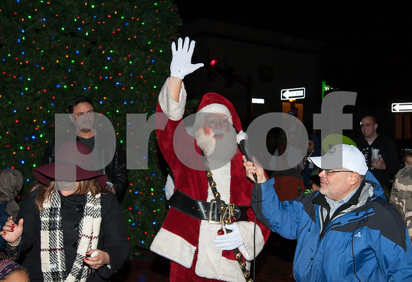 12/05/17 Wesley Bunnell | Staff New Britain held their annual Tree Lighting at Central Park on Tuesday evening with a visit from Santa Claus. Santa waves to the crowd after the tree lighting as he stands next to Executive Director of the New Britain Downtown District Gerry Amodio.