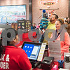 12/11/17  Wesley Bunnell   Staff<br /> <br /> Firehouse Subs opened for business on Monday at their new location at 594 Farmington Ave. Maria Hernandez, L, takes an order from Megan Huntley as she stands with her husband Chuck and son Chase, age 3.