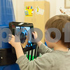 12/11/17  Wesley Bunnell | Staff<br /> <br /> Joshua Madore, age 3 1/2, plays an educational game on one of the iPad stations shaped like a crayon at the Bristol Public Library on Monday evening.