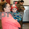 12/11/17  Wesley Bunnell   Staff<br /> <br /> Firehouse Subs opened for business on Monday at their new location at 594 Farmington Ave. Megan Huntley holds her son Chase, age 3, while the look over the menu.