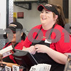 12/11/17  Wesley Bunnell   Staff<br /> <br /> Firehouse Subs opened for business on Monday at their new location at 594 Farmington Ave. Maria Hernandez, L, and Serenity Lucchesi-Nogiec smile as they assist a customer with his order.