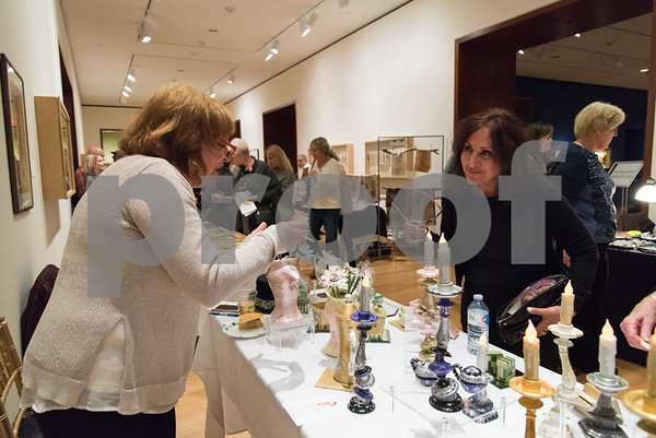 12/01/17 Wesley Bunnell | Staff The New Britain Museum of American Art held their monthly First Friday event featuring holiday shopping and music. Vendor Lorraine B. Gioco, L, helps shopper Dawn Team.