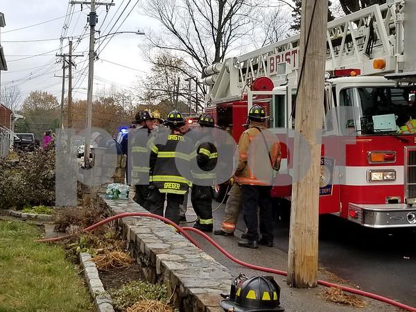 12/1/2017 Justin MuszynskiBristol firefighters on Queen Street Friday.