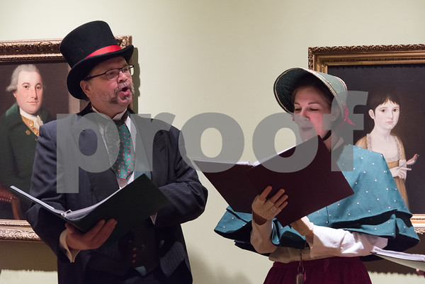12/01/17 Wesley Bunnell | Staff The New Britain Museum of American Art held their monthly First Friday event featuring holiday shopping and music. Frank Zilinyi and Meg Smith of the Connecticut Yuletide Carolers perform in the hallway near the main entrance.