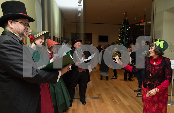 12/01/17 Wesley Bunnell | Staff The New Britain Museum of American Art held their monthly First Friday event featuring holiday shopping and music. NBMAA employee Susan Sterniak waves to the Connecticut Yuletide Carolers as she passes by. The carolers are Frank Zilinyi, Meg Smith, Mariane HIle and Michael Cartwright.