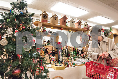 12/01/17   Wesley Bunnell | Staff  The Berlin Historical Society Annual Holiday Fair opened Friday with an additional day Saturday from 9 a.m. to 4 p.m.  A shopper looks over Christmas ornaments and decorations.