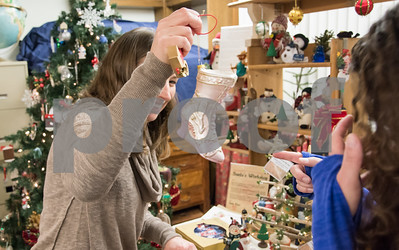 12/01/17   Wesley Bunnell | Staff  The Berlin Historical Society Annual Holiday Fair opened Friday with an additional day Saturday from 9 a.m. to 4 p.m. In keeping with their annual tradition Tammy Andersen, L, and Dawn Steimer each look for a new ornament for their trees.