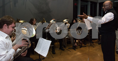 12/01/17   Wesley Bunnell | Staff  The New Britain Museum of American Art held their monthly First Friday event featuring holiday shopping and music.  The tubas play Christmas music led by conductor Walter A. Gibson on the staircase under the exhibit Boundary Conditions by Soo Sunny Park