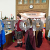 12/12/17  Wesley Bunnell | Staff<br /> <br /> The New Britain High School Madrigal Singers performed as they walked through the  public library on Tuesday morning. Robert Breau, L, and Maeve Maltese exit the childrens section with the group.
