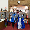 12/12/17  Wesley Bunnell | Staff<br /> <br /> The New Britain High School Madrigal Singers performed as they walked through the  public library on Tuesday morning. Giovanni Cirinna, L, and Cate Keithline, lead the singers as they exit the childrens section.