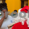 12/12/17  Wesley Bunnell | Staff<br /> <br /> New Britain OIC held their annual Christmas Party on Tuesday afternoon featuring food, music and presents for all members. Nas-zaira Watkins smiles as she walks up to receive a present from Santa.