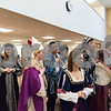 12/12/17  Wesley Bunnell | Staff<br /> <br /> The New Britain High School Madrigal Singers performed as they walked through the  public library on Tuesday morning. Nicholas Giantonio, 2nd L, and Sara Colapietro, R, perform with the group as they give their final performance in front of the circulation desk on the main floor.