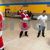12/12/17  Wesley Bunnell | Staff<br /> <br /> New Britain OIC held their annual Christmas Party on Tuesday afternoon featuring food, music and presents for all members.  Executive Director of the New Britain Downtown District Gerry Amodio, L, dances as Santa next to OIC Executive Director Paulette Fox dressed as Mrs. Claus and students Jasiry Valentin and Ashia Bravo.