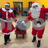 12/12/17  Wesley Bunnell | Staff<br /> <br /> New Britain OIC held their annual Christmas Party on Tuesday afternoon featuring food, music and presents for all members.  OIC Executive Director Paulette Fox dressed as Mrs. Claus brings in a wagon full of presents along with Executive Director of the New Britain Downtown District Gerry Amodio dressed as Santa.