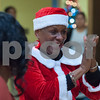 12/12/17  Wesley Bunnell | Staff<br /> <br /> New Britain OIC held their annual Christmas Party on Tuesday afternoon featuring food, music and presents for all members. OIC Executive Director Paulette Fox smiles as children receive their gifts.