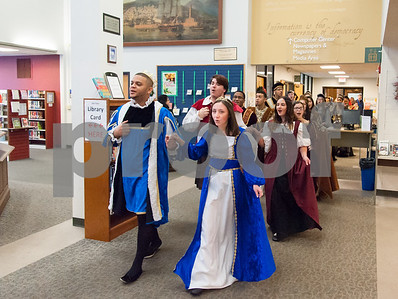 12/12/17  Wesley Bunnell | Staff  The New Britain High School Madrigal Singers performed as they walked through the  public library on Tuesday morning. Giovanni Cirinna, L, and Cate Keithline, lead the group past the circulation desk.