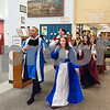 12/12/17  Wesley Bunnell | Staff<br /> <br /> The New Britain High School Madrigal Singers performed as they walked through the  public library on Tuesday morning. Giovanni Cirinna, L, and Cate Keithline, lead the group past the circulation desk.