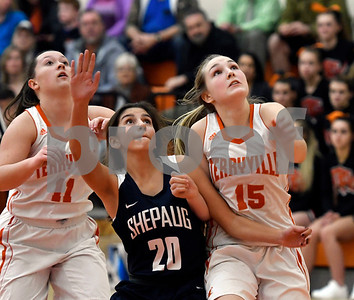 12/12/2017 Mike Orazzi | Staff Terryville High School's Tiffany Pires (15) and Shepaug's Rachel Andrews (20) during Tuesday night's girl's basketball game at THS.