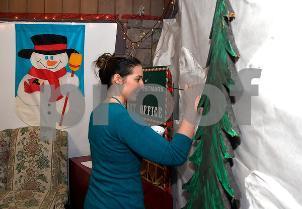 12/12/2017 Mike Orazzi | Staff Jessie Petroka while decorating Santa Land Village at Rockwell Park Tuesday evening. Each holiday season Miss Rockwell's Pavilion in Rockwell Park is transformed into a winter wonderland full of holiday fun and entertainment. Visit with Santa and Mrs. Claus, make a holiday craft, and view and elaborate train display.