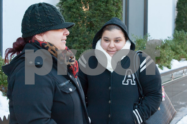 12/13/17 Wesley Bunnell | Staff Friends, both named Carmen Perez, wait in frigid conditions at the CT Transit bus station on Bank St. in downtown New Britain on Wednesday afternoon.