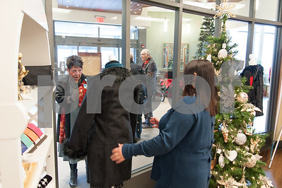12/13/17  Wesley Bunnell | Staff  The Hospital for Special Care held a ribbon cutting for their gift shop now run by Good Cause Gifts on Wednesday at noon. Store Manager Sharon Faucher looks from the outside through the store window as she directs Assistant Manager Mariel Bergeron in changes to one of the displays as seen from the front lobby.