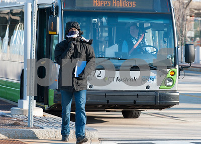 12/13/17  Wesley Bunnell | Staff  A passengers exits a CTfastrak bus on a windy and cold Wednesday afternoon at the CTfastrak station in downtown New Britain.