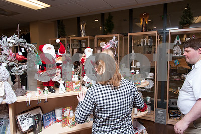 12/13/17  Wesley Bunnell | Staff  The Hospital for Special Care held a ribbon cutting for their gift shop now run by Good Cause Gifts on Wednesday at noon. Good Cause Gifts provides training and employment to individuals with disabilities. Store employees Megan and Dan help straighten the shelves for customers.