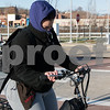 12/13/17  Wesley Bunnell | Staff<br /> <br /> Crystal Perez is dressed for the frigid weather as she rides her bike through the CTfastrak station on Wednesday afternoon.