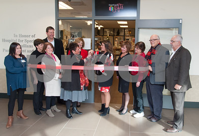 12/13/17  Wesley Bunnell | Staff  The Hospital for Special Care held a ribbon cutting for their gift shop now run by Good Cause Gifts on Wednesday at noon.  Assistant Manager Mariel Bergeron, L, holds the ribbon along with Alderman Don Naples, R, as Store Manager Sharon Gaucher prepares to cut the ribbon with Mayor Erin Stewart. President and CEO of the Hospital for Special Care Lynn Ricci, 8th from L, and Economic Development Director Bill Carrol , far R.