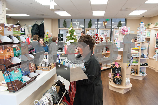12/13/17 Wesley Bunnell | Staff The Hospital for Special Care held a ribbon cutting for their gift shop now run by Good Cause Gifts on Wednesday at noon. Store manager Sharon Faucher stocks the register area with items for sale.