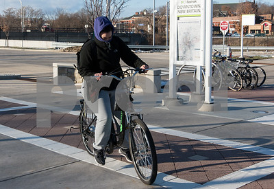 12/13/17  Wesley Bunnell | Staff  Crystal Perez is dressed for the frigid weather as she rides her bike through the CTfastrak station on Wednesday afternoon.