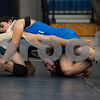 12/13/17  Wesley Bunnell | Staff<br /> <br /> Plainville wrestling defeated Newington Wednesday evening at Plainville High School.  Newington's Emilio Cruz, bottom, and Plainvlle's Dominic Pedrolini in the 120lb contest.
