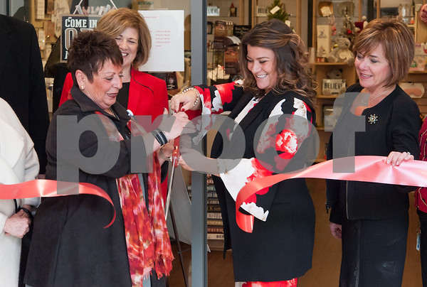12/13/17 Wesley Bunnell | Staff The Hospital for Special Care held a ribbon cutting for their gift shop now run by Good Cause Gifts on Wednesday at noon. Store Manager Sharon Gaucher cuts the ribbon with Mayor Erin Stewart as President and CEO of the Hospital for Special Care Lynn Ricci, R, looks on.