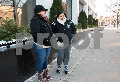 12/13/17  Wesley Bunnell | Staff  Friends, both named Carmen Perez, wait for their bus in frigid conditions at the CT Transit bus station on Bank St. in downtown New Britain on Wednesday afternoon.