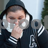 12/13/17  Wesley Bunnell | Staff<br /> <br /> Carmen Perez bundles up as a strong wind whips down Bank St. at the CT Transit bus station in downtown New Britain on Wednesday afternoon.