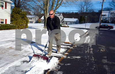 12/14/2017 Mike Orazzi | Staff Dave Jakubiak shovels snow off his sidewalk along Maheu Street in Bristol after a coating of snow early Thursday.