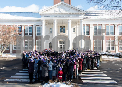 12/14/17  Wesley Bunnell | Staff  Almost 500 people gathered in the shape of a heart outside of Davidson Hall on CCSU's campus wearing purple hats with the hashtag #CCSULoveWins in honor of Ana Grace on the 5th anniversary of the Sandy Hook shootings.  As a camera drone flies overhead participants hold their hands heart shaped for a photo.