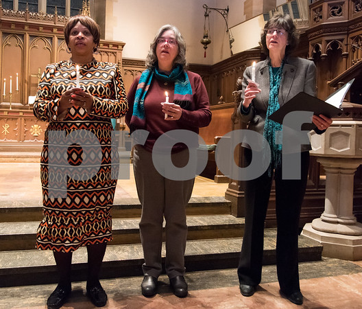 12/14/17 Wesley Bunnell | Staff A Prayer Vigil Against Gun Violence was held at South Church on Thursday evening to remember the shooting at Sandy Hook on its 5th anniversary. Pastor Pauline Wilkins of Another Chance Church stands with Rev. Margret Hofmeister of First Church of Christ and Rev. Jane H. Rowe of South Church as they hold lit candles to send a message of unity and remembrance of the mass shooting.