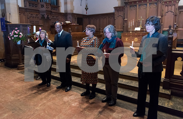 12/14/17 Wesley Bunnell | Staff A Prayer Vigil Against Gun Violence was held at South Church on Thursday evening to remember the shooting at Sandy Hook on its 5th anniversary. Holding lit candles to send a message of unity and remembrance of the mass shooting are Ms. Fatma Antar of the Islamic Association of Greater Hartford, Ms. Ann Speyer of Temple Sinai, Rev. Gervais Barger of Peace Missionary Ministries, Pastor Pauline Wilkins of Another Chance Church, Rev. Margret Hofmeister of First Church of Christ and Rev. Jane H. Rowe of South Church.