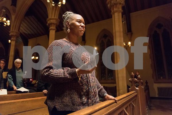 12/14/17 Wesley Bunnell | Staff A Prayer Vigil Against Gun Violence was held at South Church on Thursday evening to remember the shooting at Sandy Hook on its 5th anniversary. Andrea Scott stands with a lit candle to send a message of unity and remembrance of the mass shooting.