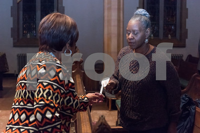 12/14/17  Wesley Bunnell | Staff  A Prayer Vigil Against Gun Violence was held at South Church on Thursday evening to remember the shooting at Sandy Hook on its 5th anniversary. Pastor Pauline Wilkins of Another Chance Church lights a candle for Andrea Scott to send a message of unity and remembrance of the mass shooting.