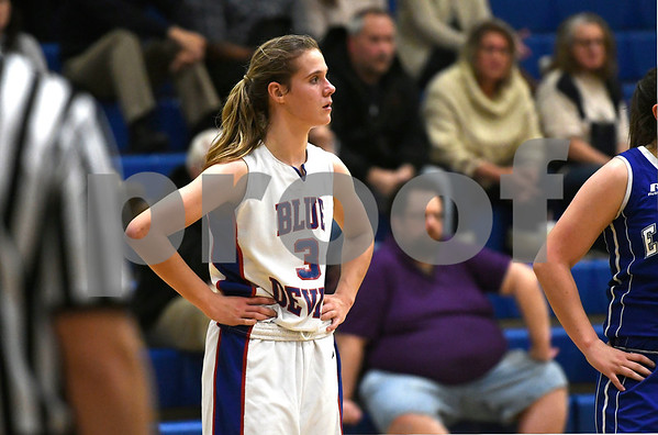 12/14/2017 Mike Orazzi | Staff Plainville'sCaitlin Barker (3) Thursday night in Plainville.