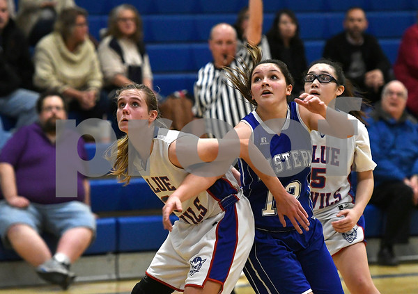 12/14/2017 Mike Orazzi   Staff Plainville'sCaitlin Barker (3) and Bristol Eastern's Karly Martin (12) Thursday night in Plainville.