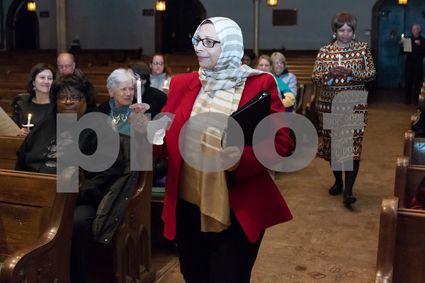 12/14/17 Wesley Bunnell | Staff A Prayer Vigil Against Gun Violence was held at South Church on Thursday evening to remember the shooting at Sandy Hook on its 5th anniversary. Ms. Fatma Antar of the Islamic Association of Greater Hartford walks down the aisle after helping to light visitors candles to send a message of unity and remembrance of the mass shooting.