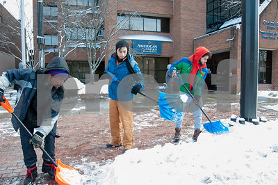 12/14/17  Wesley Bunnell | Staff  Marc Anderson, Josh Menzieta and Wissan Aljhmi with T@T Landscaping clear the sidewalk in front of the CCSU ITBD building on Thursday morning after an overnight snow storm.