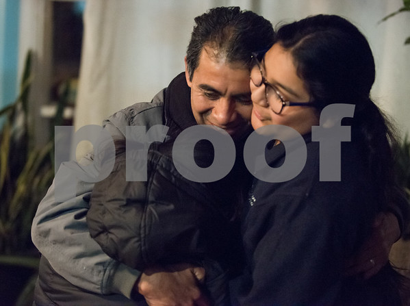 12/15/17 Wesley Bunnell | Staff New Britain resident Mario Cardoso Sr. was given a last minute stay of removal Friday afternoon on the day he was facing deportation to his native Mexico. Mario Cardoso Sr. hugs two of his nieces during a press conference on Friday evening at his New Britain home.