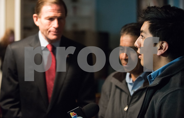 12/15/17 Wesley Bunnell | Staff New Britain resident Mario Cardoso Sr. was given a last minute stay of removal Friday afternoon on the day he was facing deportation to his native Mexico. Mario Cardoso Jr, R, speaks to the media as his father stands by his side next to Senator Richard Blumenthal.