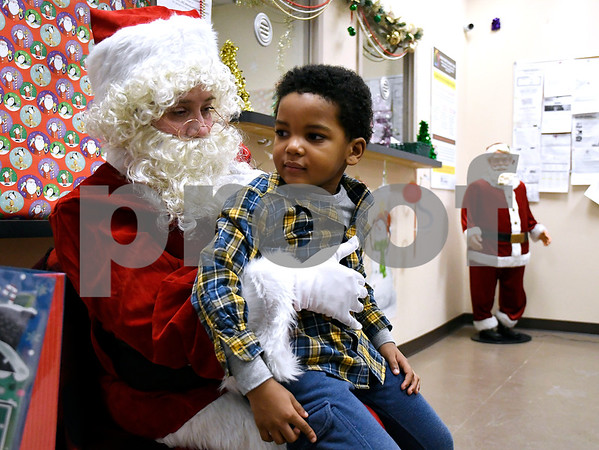 12/15/2017 Mike Orazzi | Staff Jamai Owens,3, with Santa during a Christmas party Friday afternoon in Bristol at the Human Resources Agency of Bristol.
