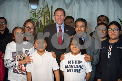 12/15/17  Wesley Bunnell | Staff  New Britain resident Mario Cardoso Sr. was given a last minute stay of removal Friday afternoon on the day he was facing deportation to his native Mexico. Mario Cardoso Sr. poses to the right of Senator Richard Blumenthal during a family and friends photograph on Friday evening at the conclusion of a press conference held at their New Britain home.